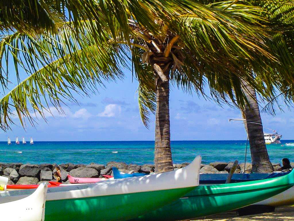 Canoes resting on the beaches of Lanikai Beach in Kailua, Oahu