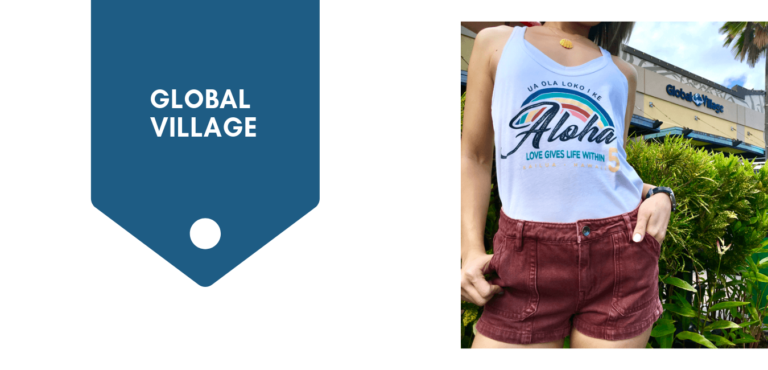 Global Village Graphic with model in store shirt in front of Global Village Kailua shop.